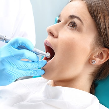 A patient getting comfortable root canal therapy.