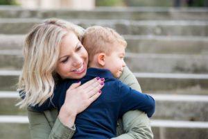 Dr. Gavin hugging her son on steps outside
